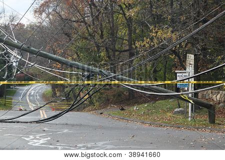 GREENWiCH, CT - NOVEMBER 02:  Broken electrical pole on Lake Avenue near Exit 28 on the Merritt Parkway after hurricane Sandy 2012 on November 02, 2012 in Greenwich, CT.