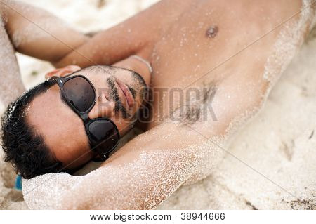 Portrait of an attractive young model on a tropical beach