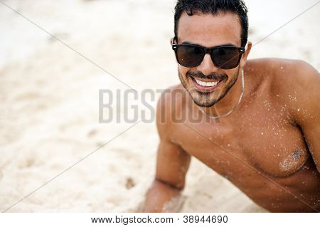 Portrait of an attractive young model on a beach