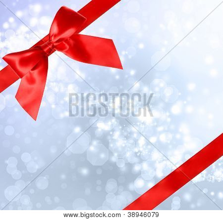 Red Bow And Ribbon With Bokeh Lights