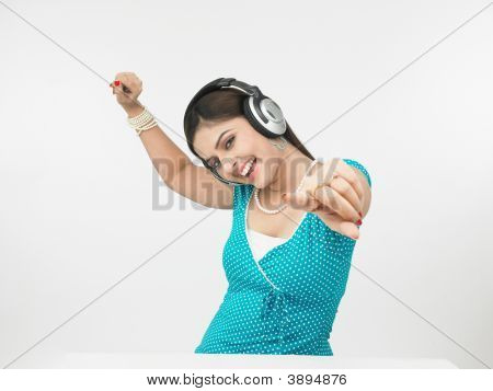 Asian Female Enjoying Music