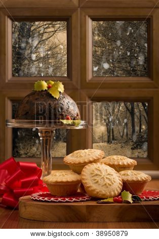 Christmas mince pies against snowy outdoor scene