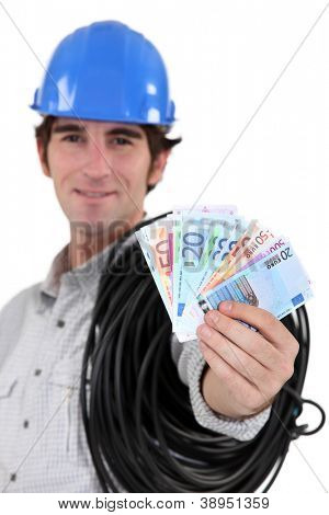 Electrician showing wad of bills