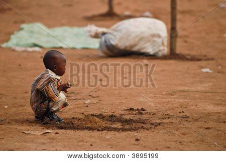 Small African Boy Squatting
