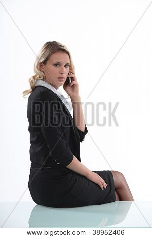 Austere businesswoman talking on her mobile phone