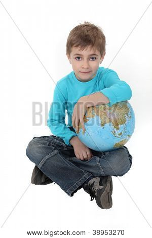 Pale boy with a globe in his lap