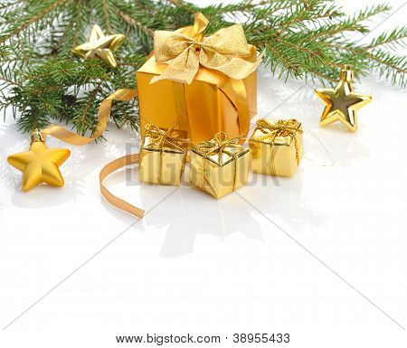 decorated golden gift boxes  under Christmas tree on white  background