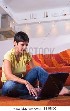 Young Woman Is Using A Laptop