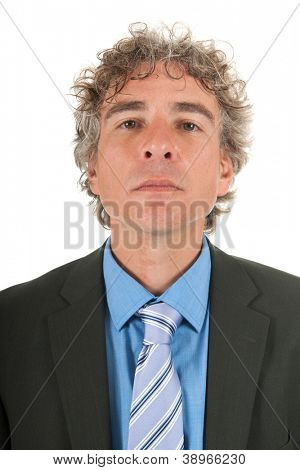 portrait handsome arrogant adult man with curly hair and formal suit