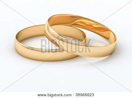 Wedding rings on a light background with reflections