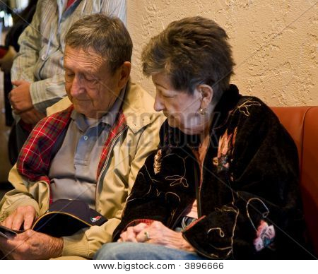 Old Couple Looking At Menu