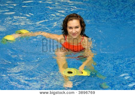 Woman In Water With Dumbbels