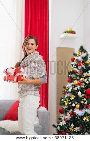 Happy Woman With Present Boxes Preparing For Christmas