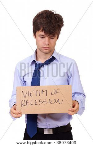 Depressed jobless young businessman holding a cardboard: victim of recession, isolated on white background