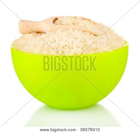 rice in a yellow  plate with a wooden scoop  , isolated on white