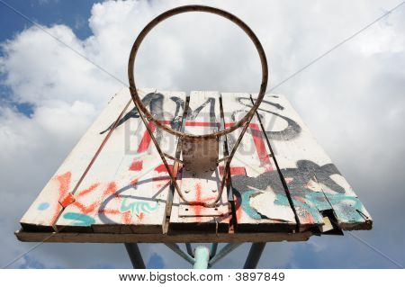 A Basketball Hoop With Graffity.