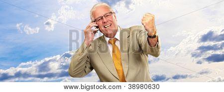 Senior Business Man Using Phone Cheering, Outdoor