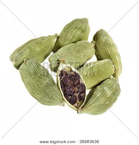 Green cardamom seeds on a white background