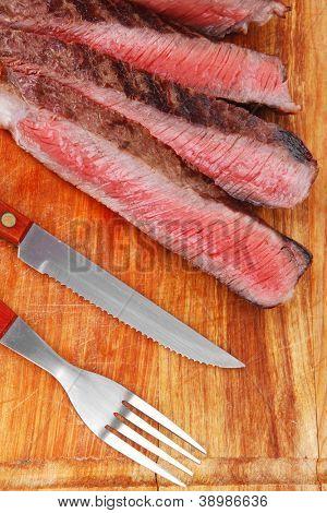 meat food : roast beef steak on wood plate isolate on white background