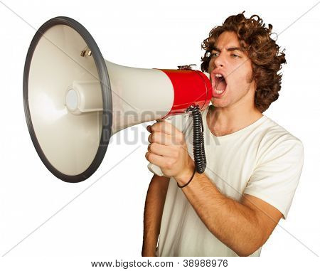Portrait Of A Handsome Young Man Shouting With Megaphone On White Background