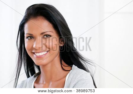 Beautiful latin woman smiling and looking at camera isolated on white background