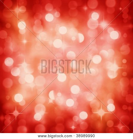 Background of defocused red lights with sparkles. Christmas, New Years, disco party bokeh
