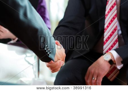 Man shaking hands with manager at job interview closeup cutout employment candidate hiring resume CEO work business