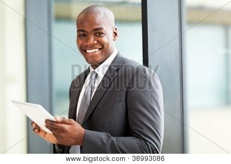 male african american office worker with tablet computer