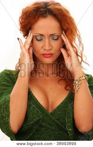 Atractive redhead woman have a headache isolated on a white