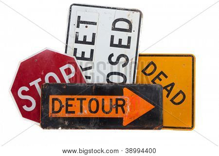 Assorted Road signs including dead end, stop, detour and street closed on a white background