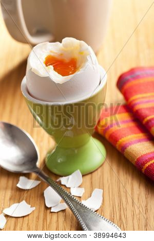 boiled egg in eggcup on wooden table