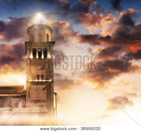 Ancient tower topped with modern light pyramid against dramatic sky