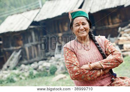 India authentic smiling woman - country dweller of Indian himachal pradesh state kinnaur village