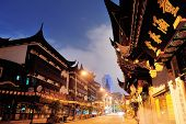 SHANGHAI, CHINA - MAY 30: Chenghuangmiao street at night with pagoda style buildings on May 30, 2012