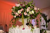 pic of flower arrangement  - Colorful wedding bouquet with appetizers and cakes - JPG