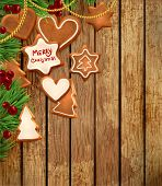 stock photo of holly  - Gingerbread cookies with Christmas tree branches and Holly berries - JPG