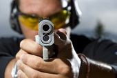 image of shooting-range  - Man shooting on an outdoor shooting range - JPG