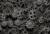 stock photo of grids  - many old rusty metal gears or machine parts - JPG