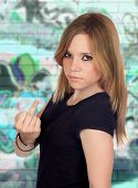 picture of insulting  - Attractive aggressive woman making an insulting gesture - JPG