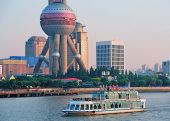 SHANGHAI, CHINA - JUNE 2: Oriental Pearl Tower over river on JUNE 2, 2012 in Shanghai, China. The to