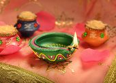 stock photo of pooja  - An Indian lamp and tiny earthen pots - JPG