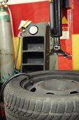 Inflating a tire in auto repair shop before mounting a wheel to the car