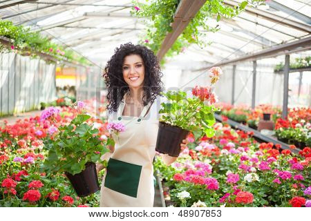 Beautiful woman holding flower pots