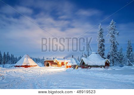Winter landscape with cabin hut at night in Kiruna Sweden lapland at Night with star trail