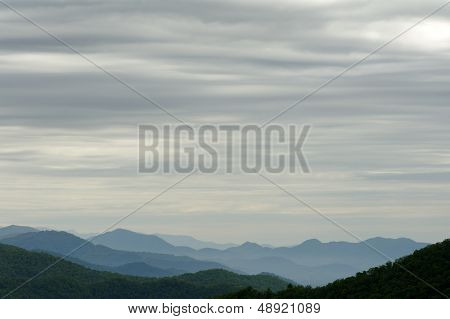 Layers Of Clouds And Mountains