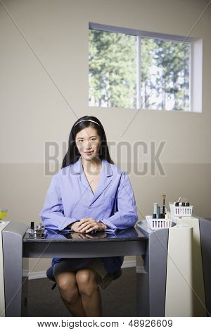 Nail technician sitting at desk