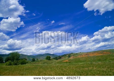 Landscape With Fluffy Clouds