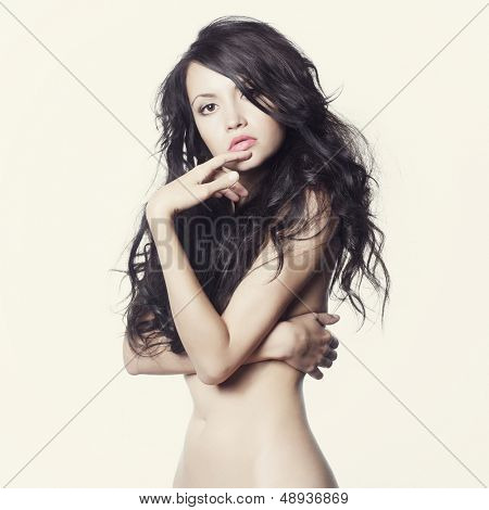 Photo of young naked lady with long perfect hair