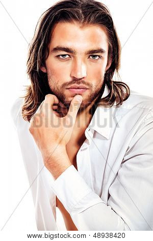 Portrait of a handsome man in an unbuttoned white shirt. Isolated over white.