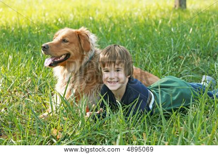 Boy Laying Down With Dog